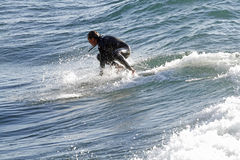 Surfing , Michigan. Surfer catches wave on Lake Superior, Michigan Royalty Free Stock Photo