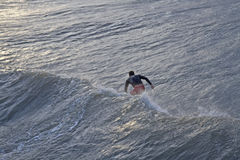 Surfing a Large Hurricane Wave Stock Photo