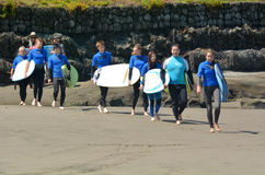 Surfing lesson in Muriwai beach - New Zealand Royalty Free Stock Photo