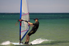 Surfing man. Man wind surfing and have healthy lifestyle in Aegean sea Stock Images