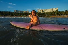 Surfing man with baby Royalty Free Stock Photography