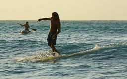 Surfing man. On the board in sunset light Royalty Free Stock Images