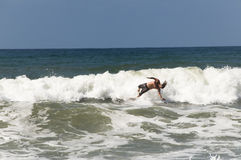 Surfing man Stock Photo