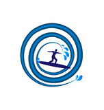 Surfing man in a swirly blue wave Royalty Free Stock Photos