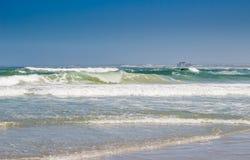 Surfing at Melkbosstrand beach with Koeberg Nuclear Power Statio Stock Image