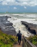 Surfing at Muriwai Beach, West Coast of North Island of New Zealand. January 8, 2018 royalty free stock photography