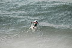 Surfing in Myrtle Beach SC. Myrtle beach SC sand ocean and Sea stock photography