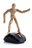 Surfing the net. Wooden artist's figure on computer mouse concept for surfing the net Royalty Free Stock Photos