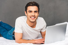 Surfing net in bed. Stock Images