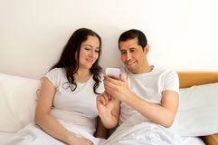 Surfing the net in the bedroom Royalty Free Stock Photo