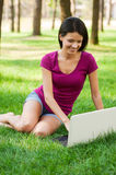 Surfing the net outdoors. Stock Photo