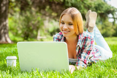 Surfing the net outdoors. Royalty Free Stock Image