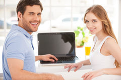 Surfing the net together. Royalty Free Stock Images