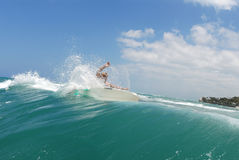 Surfing off the lip. A shortboard surfer surfing on a beautiful wave in hawaii stock photo