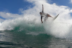 Surfing off the lip. A shortboard surfer surfing on a beautiful wave in hawaii royalty free stock photo