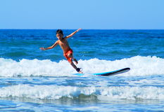 Kid on surf board Stock Photo