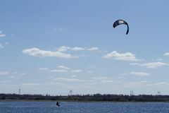 Surfing with a parachute. A kite surfer on a beautiful summer day Royalty Free Stock Photography