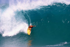 Surfing the Pipeline in Hawaii Stock Photo