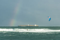 Surfing and rainbow Royalty Free Stock Images