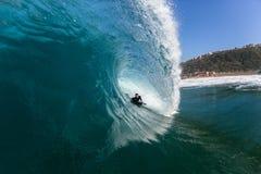 Surfing Rider Hollow Crashing Tube Blue Ocean Wave stock photo