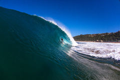 Surfing Riding Blue Hollow Wave Royalty Free Stock Photos