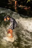 Surfing on the River - Englischer Garten Munich stock photography
