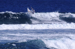 Surfing Samoa. A man surfing a wave in Samoa Stock Photography