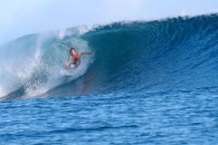 Surfing Samoa. A surfer catching a nice barrel in Samoa Royalty Free Stock Photo