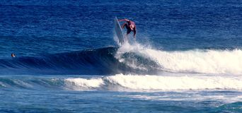 Surfing Samoa. A surfer catching a some air whilst surfing in Samoa Stock Images