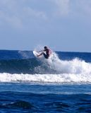Surfing Samoa. A surfer catching a wave in Samoa Stock Photo