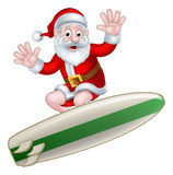 Surfing Santa Stock Photography