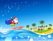 Surfing Santa With Gifts Stock Photography
