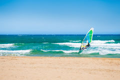 Surfing on the sea coast. Royalty Free Stock Image