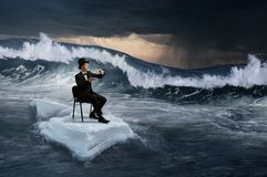 Surfing sea on ice floe. Mixed media. Businessman on ice block floating in sea and having coffee. Mixed media Royalty Free Stock Photography
