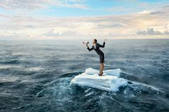 Surfing sea on ice floe. Mixed media. Businesswoman on ice block floating in sea . Mixed media Stock Photos