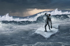 Surfing sea on ice floe. Young businessman floating on ice block in sea. Mixed media Royalty Free Stock Photos