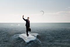 Surfing sea on ice floe Stock Photo