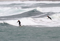Surfing at Sennen Cove Cornwall Royalty Free Stock Photos