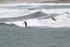 Surfing at Sennen Cove Cornwall Royalty Free Stock Photography