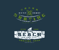 Surfing shop emblems. Graphic design for t-shirt. Color print on dark background Stock Photography