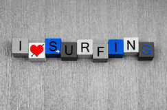 Surfing, sign series for surfers, watersports and love of the surf. Surfing, sign for surfers and water sports, with small fish icon royalty free stock photo