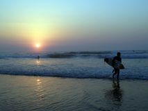Surfing at sopelana beach. (sunset royalty free stock photos