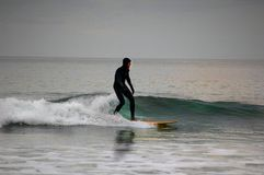 Surfing on the southwest coast Devon. Surfing  is a very popular sport here in the westcountry especially Devon and Cornwall Royalty Free Stock Image