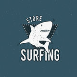 Surfing store emblem design. Shark on a triangle sheld. Retro rough style. Surfing logo template isolated on blue. Background. summer insignia Stock Image