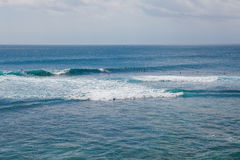 Surfing at Suluban beach, Bali, Indonesia Royalty Free Stock Photography