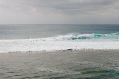 Surfing at Suluban beach, Bali, Indonesia Stock Images