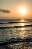 Surfing at Sunset. Backlight Silhouette Surfer in the Ocean at Sunset Stock Images