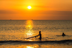 Surfing at Sunset Stock Photos