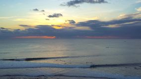 Surfing at sunset at Uluwatu blue point, Bali stock footage