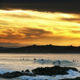 Surfing at sunset. In the Valdearenas beach (Cantabria, Spain stock photos